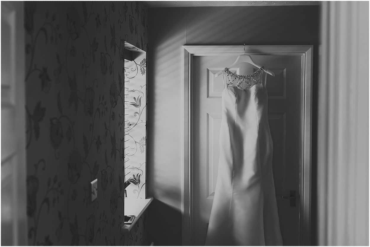 Lincolnshire photography black and white image of a dress hanging on a doorframe