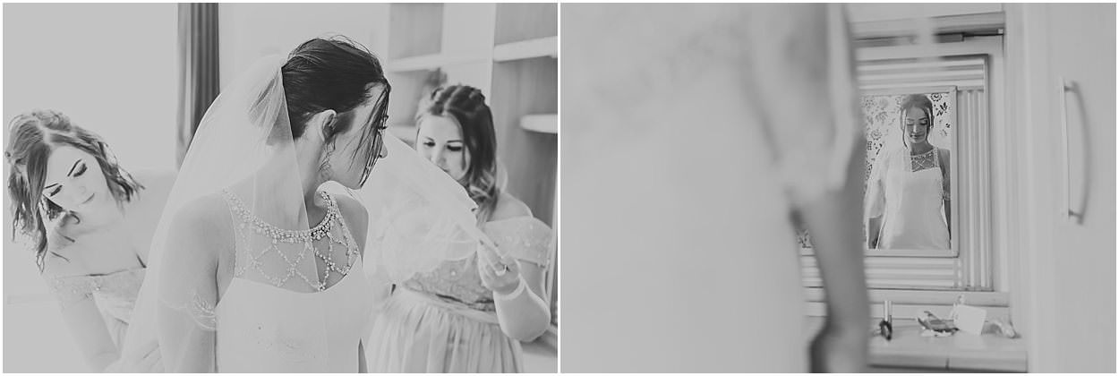 Lincolnshire photography black and white images of a bride having her dress done up