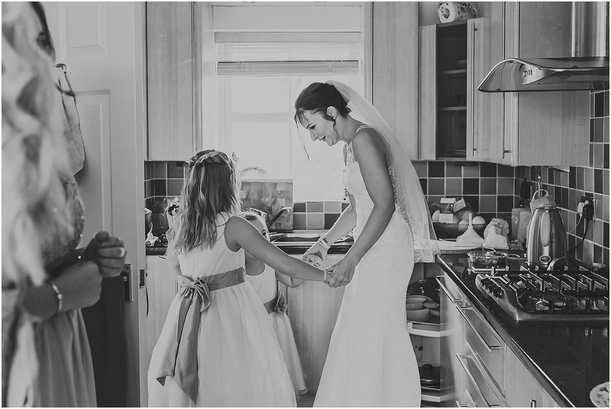 Lincolnshire photography bride dancing with her daughters in the kitchen