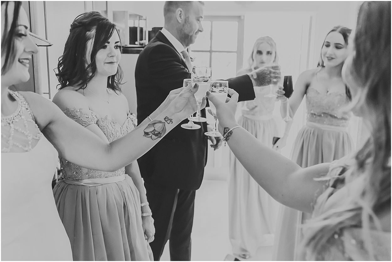 Lincolnshire photography Bridal party and father of the bride drinking prosecco