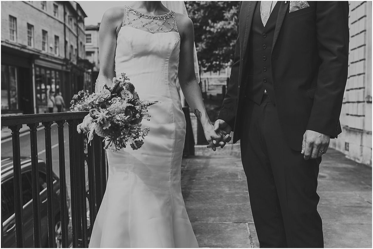Lincolnshire photography bride and groom stood on the steps outside stamford town hall
