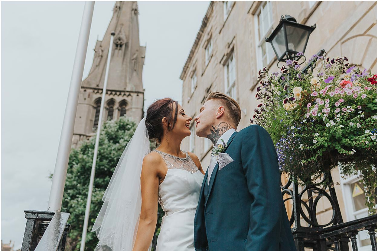 Lincolnshire photography bride and groom on steps outside Stamford town hall