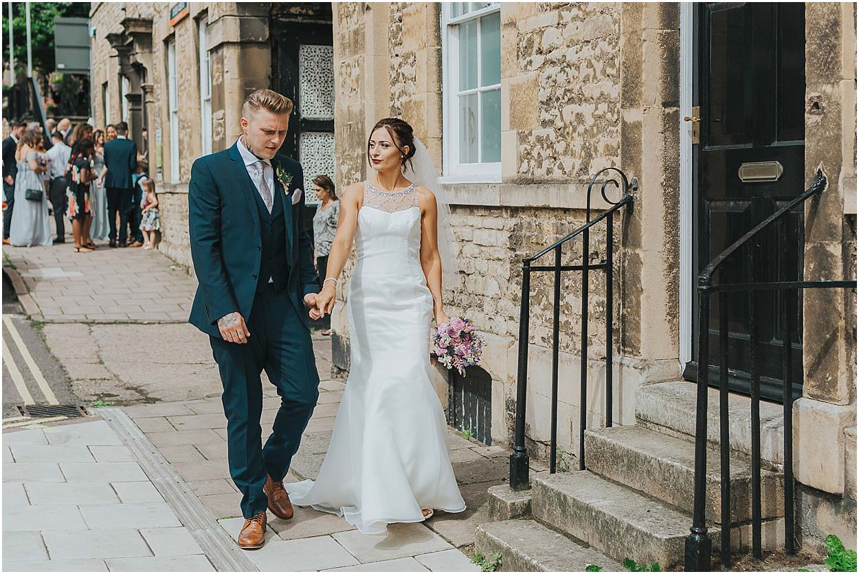 Lincolnshire photography bride and groom walking away from the register office