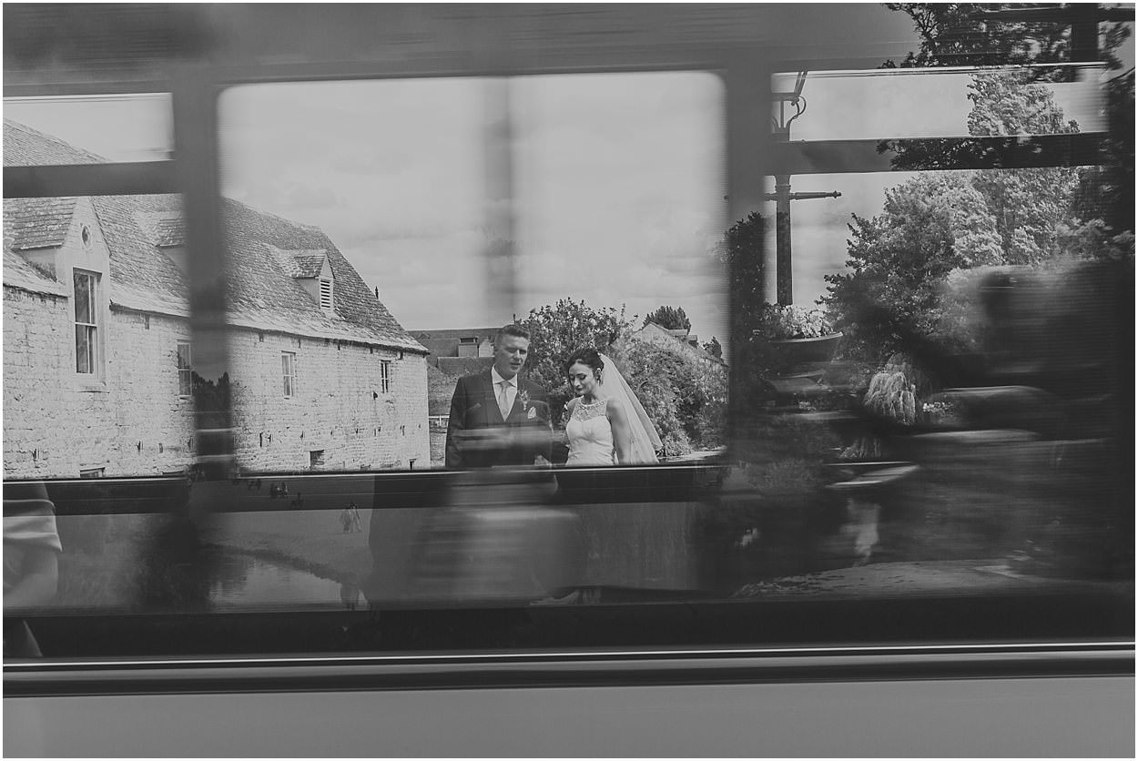 Lincolnshire photography bride and groom candid through a bus window