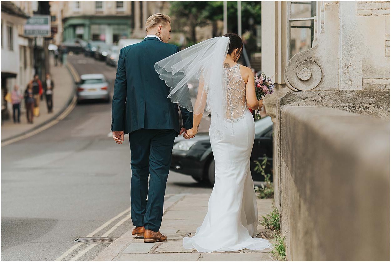 Lincolnshire photography bride and groom crossing a bridge