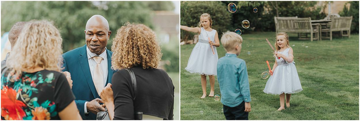 Lincolnshire photography guests at a wedding socialising, children playing with bubbles