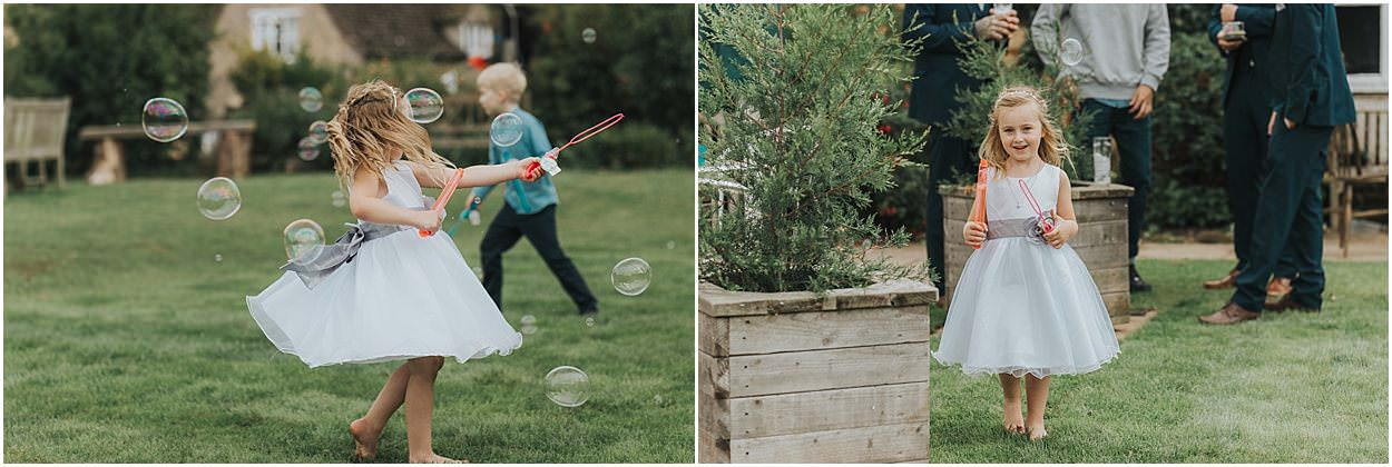 Lincolnshire photography children playing with bubbles at a wedding