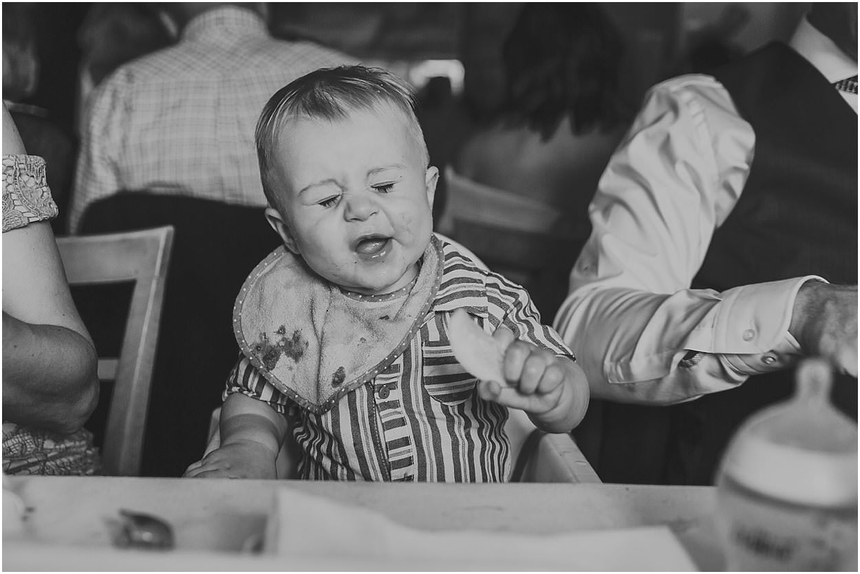 Lincolnshire photography bride and groom's son eating a lemon