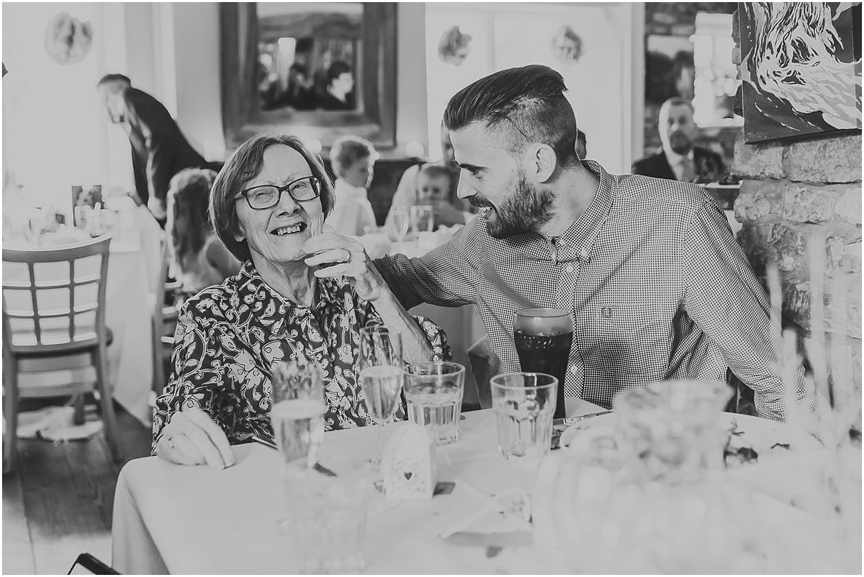 Lincolnshire photography wedding guest and his grandma laughing