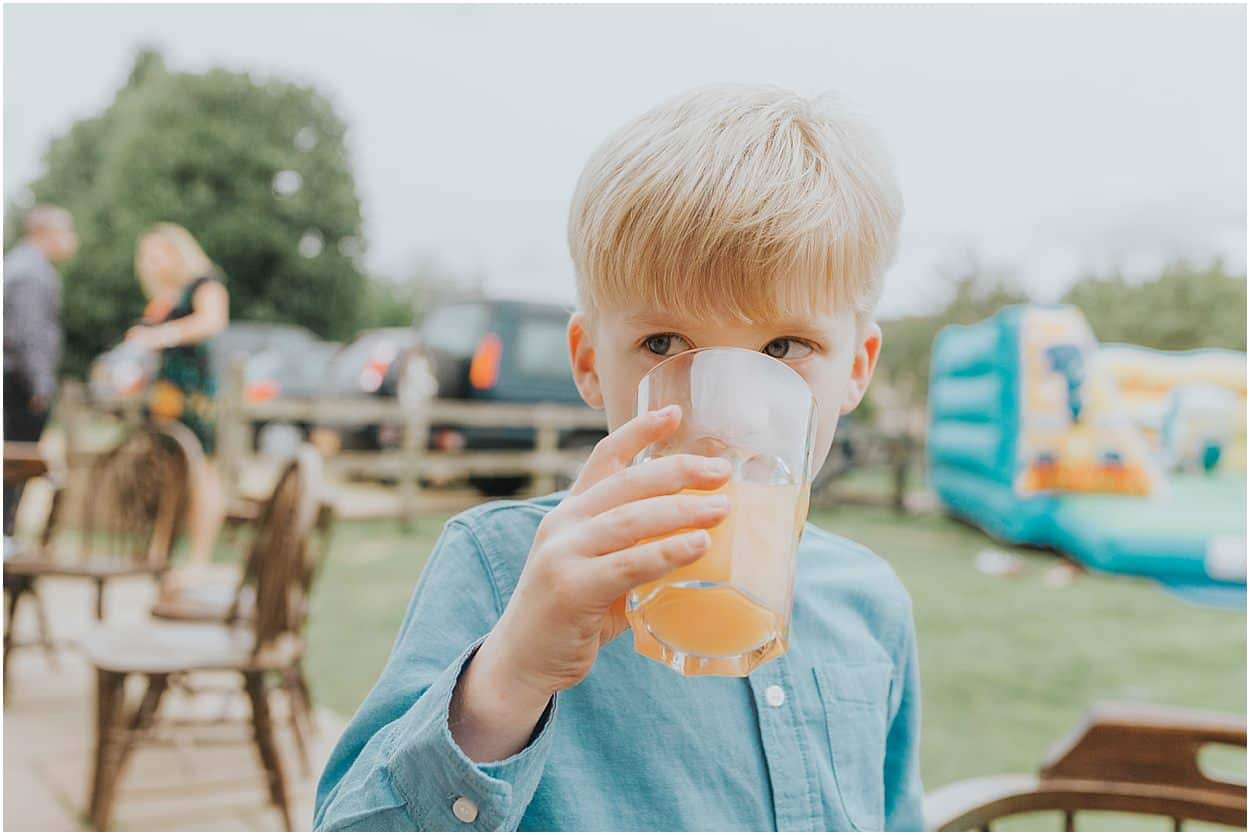 Lincolnshire photography small boy drinking juice at a wedding