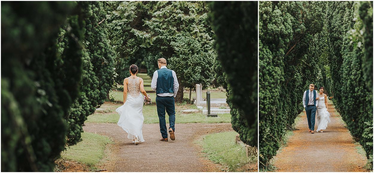 Lincolnshire photography bride and groom walking between trees