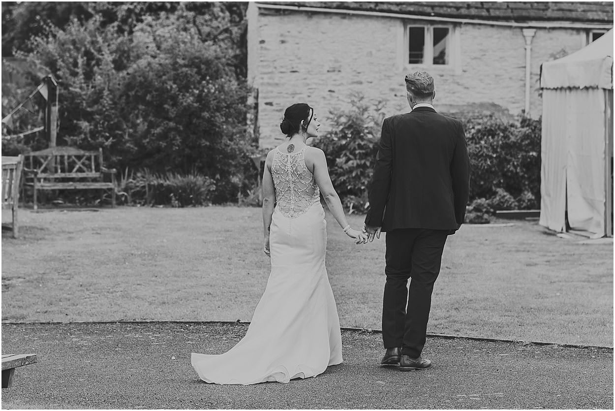 Lincolnshire photography bride and groom walking towards venue