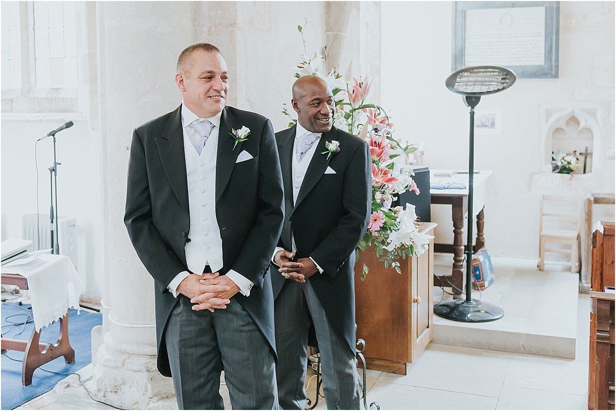 Rutland and Lincolnshire photography groom and best man's reaction to the bride walking down the aisle