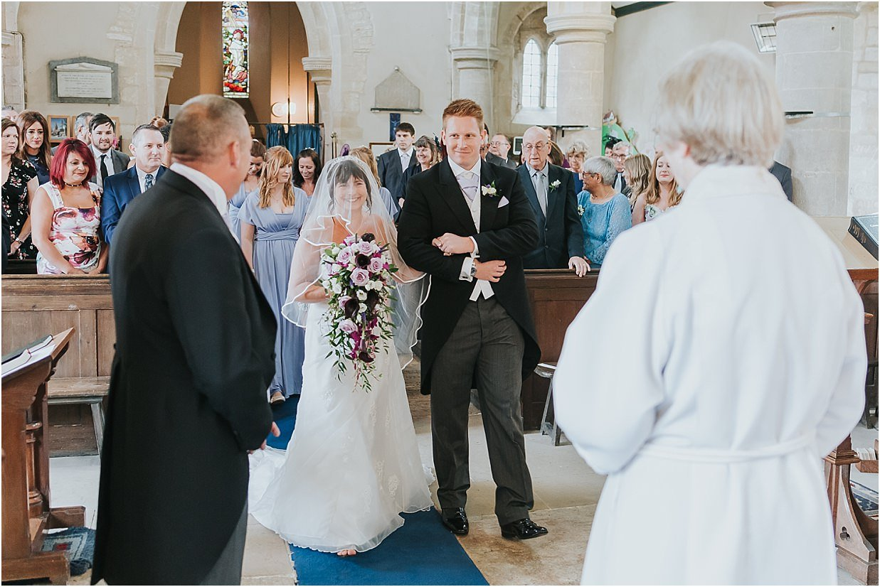 Rutland and Lincolnshire photography bride arriving at the altar with her son