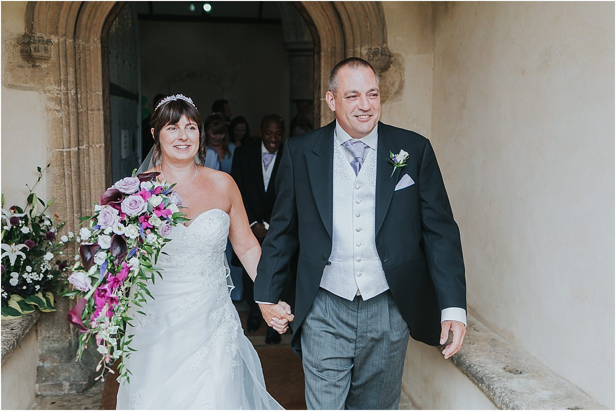 Rutland and Lincolnshire photography bride and groom outside church