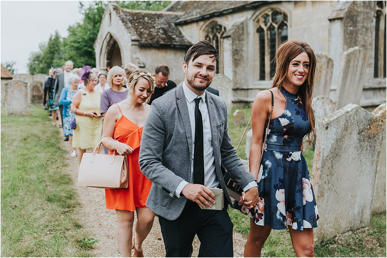Rutland and Lincolnshire photography couple leaving church after wedding