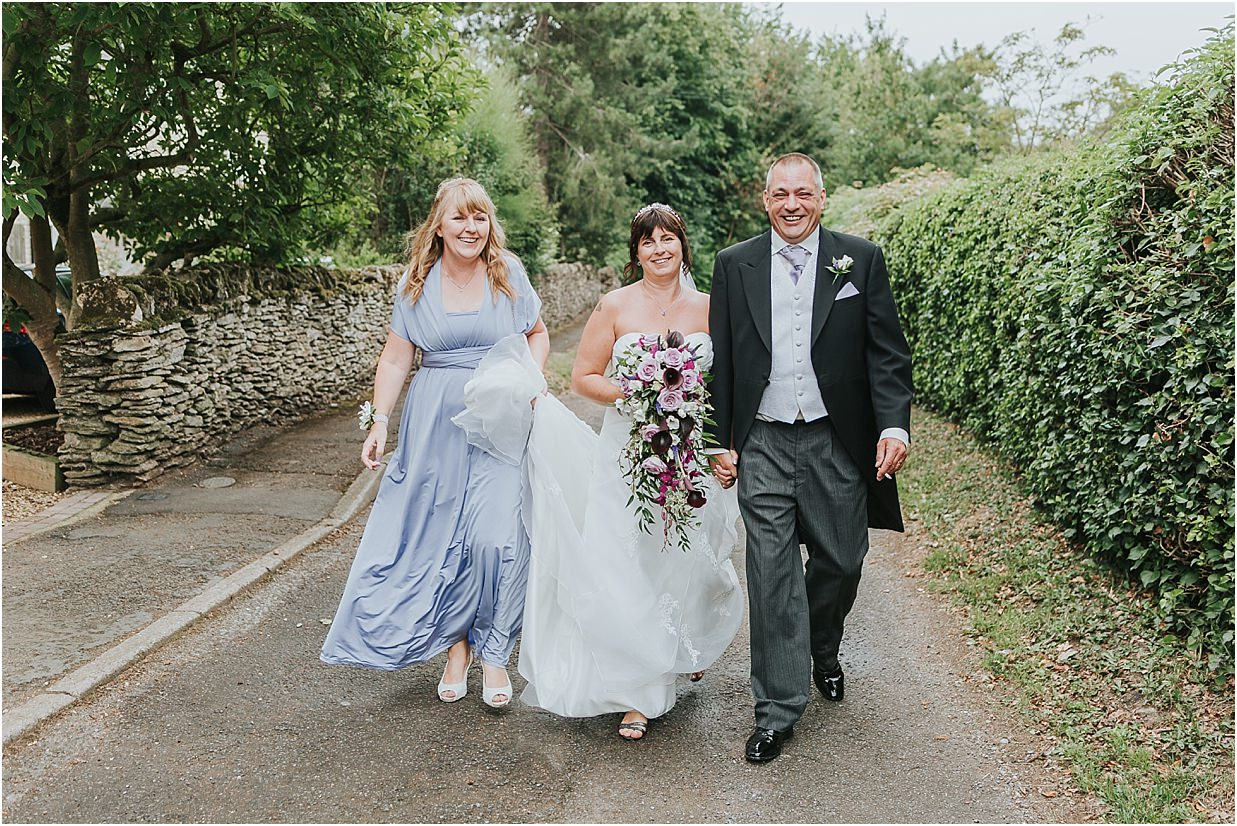 Rutland and Lincolnshire photography bride groom and maid of honour walking towards camera