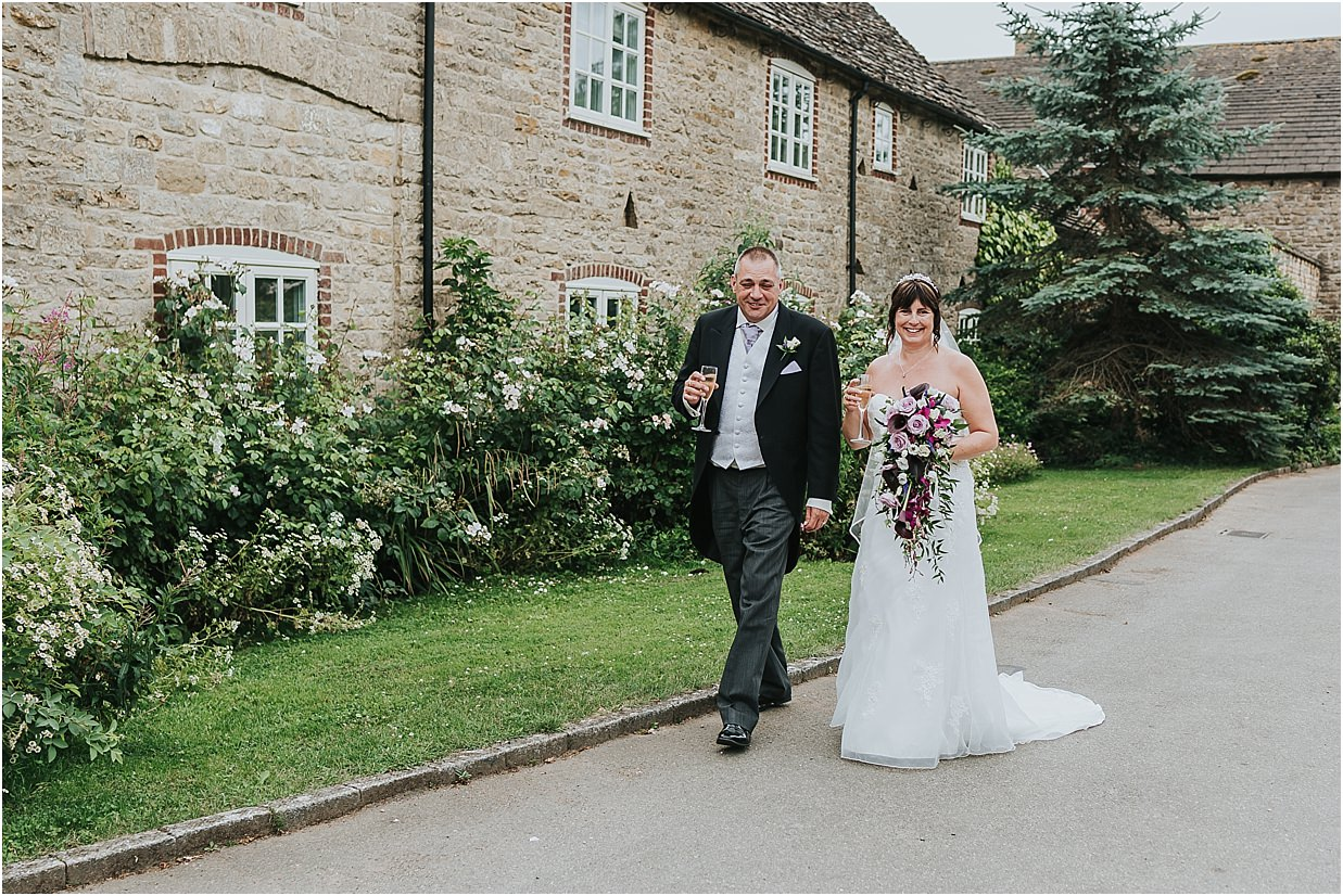 Rutland and Lincolnshire photography bride and groom walking in front of Barnsdale Lodge hotel Oakham