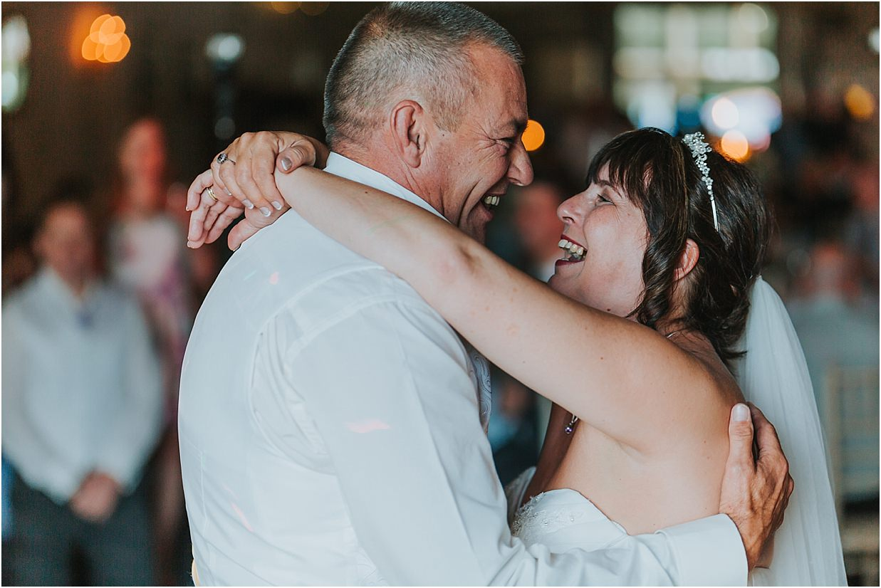 Rutland and Lincolnshire photography bride and groom embracing during their first dance at Barnsdale lodge hotel