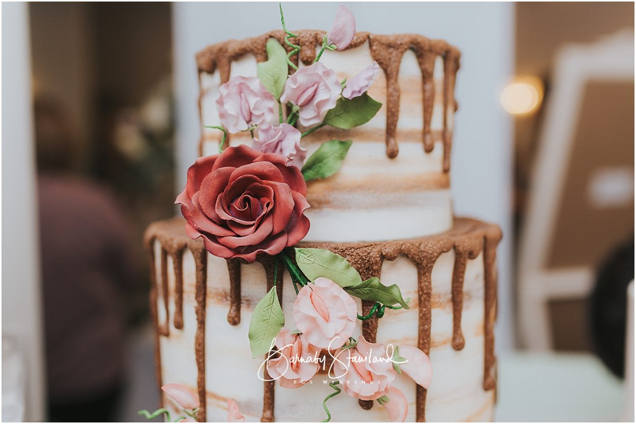 Rutland Wedding Photography naked cake dripping frosting and a rose