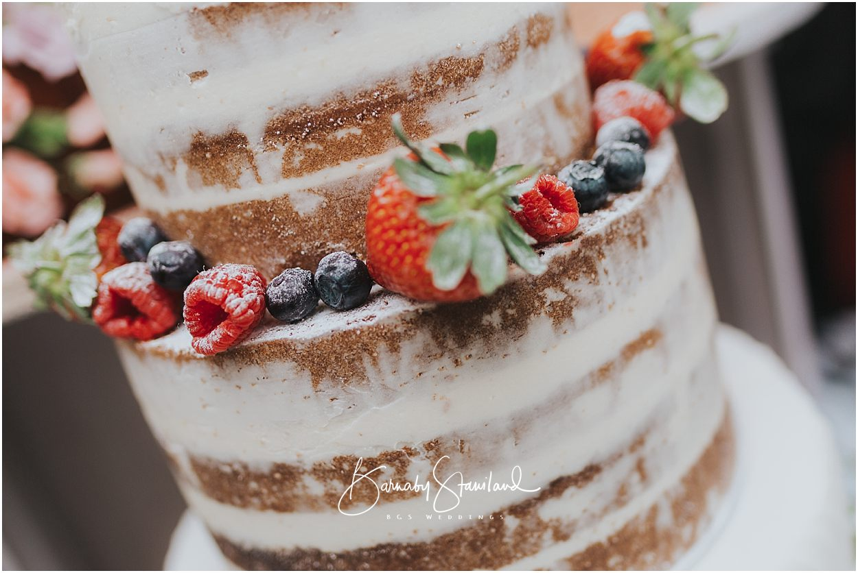 Rutland Wedding Photography naked wedding cake with raspberries, blueberries and strawberries
