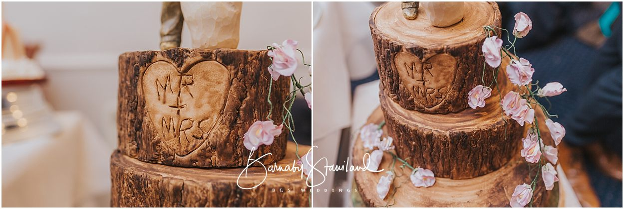 Rutland Wedding Photography wedding cake which looks like a tree stump saying mr and mrs on