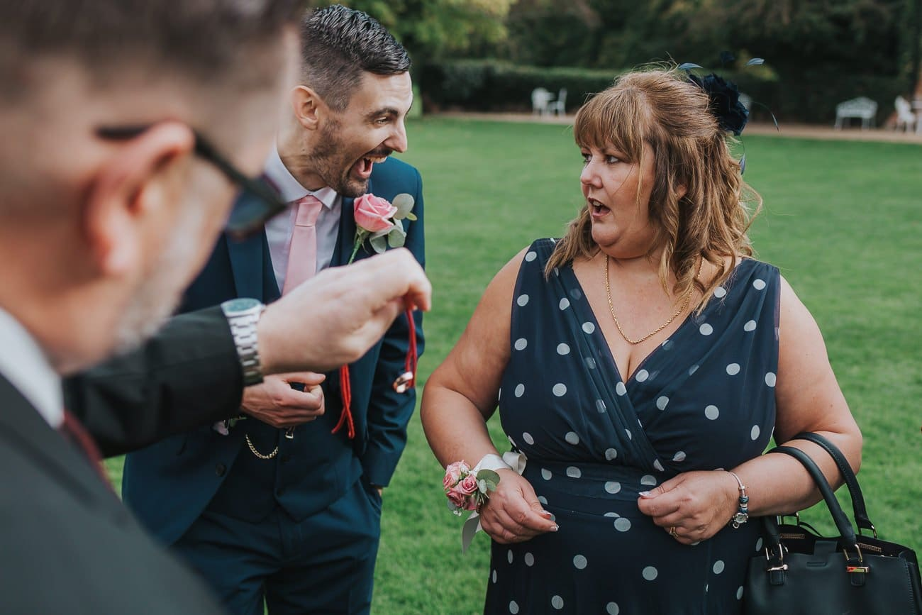 Mother of the groom reacting to a magic trick
