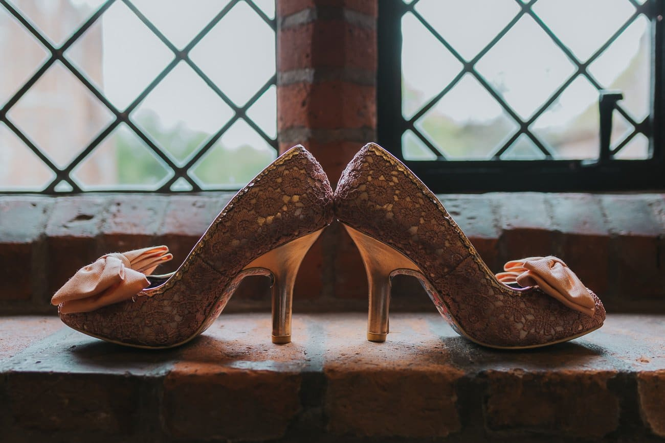 Irregular choice wedding shoes on a windowsill