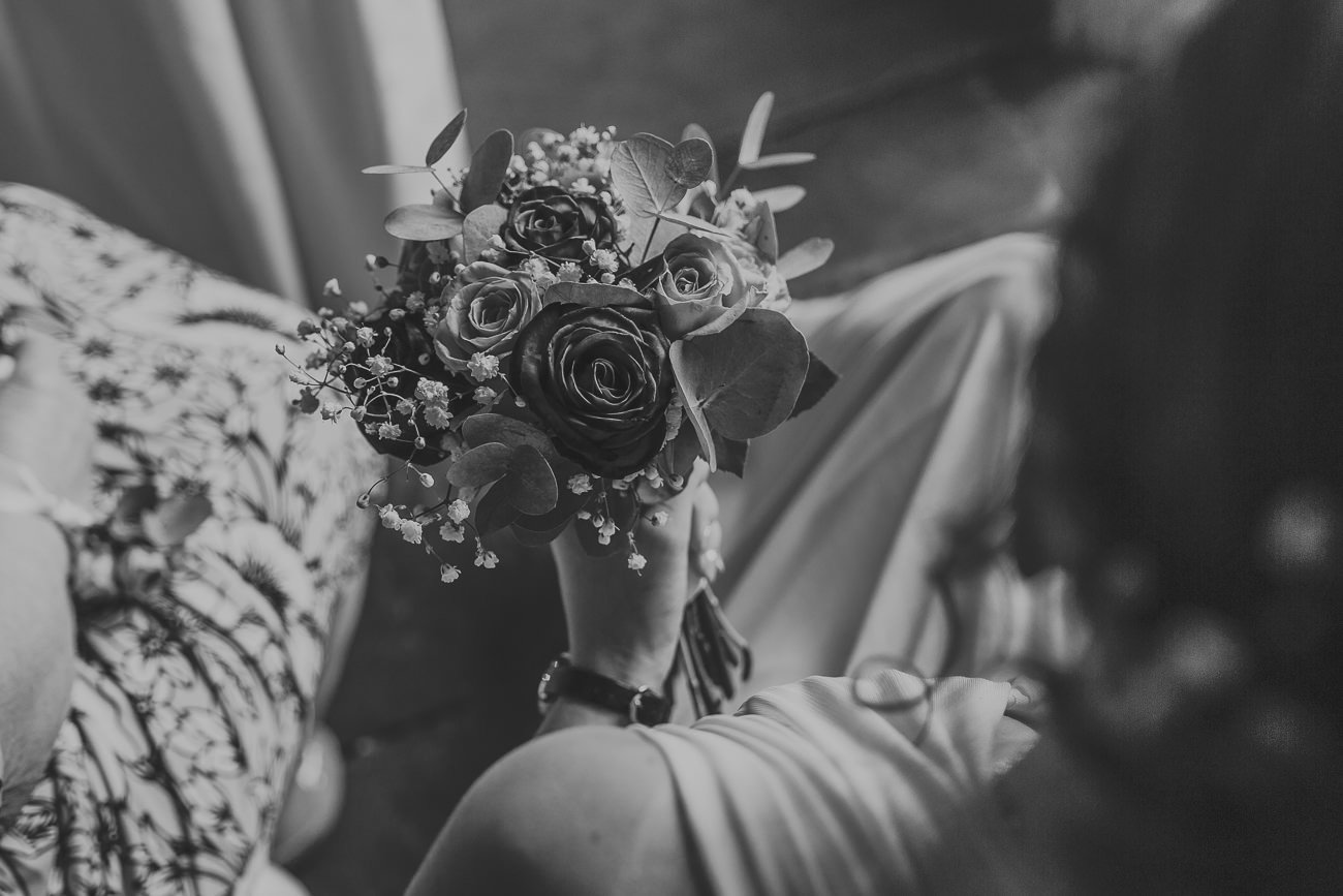 Bridesmaid holding her bouquet in black and white