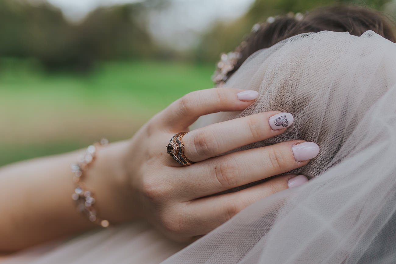 Bride's hand and wedding rings