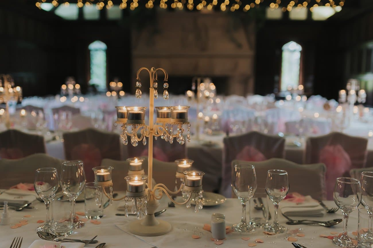 Table setting at a wedding with fairy lights