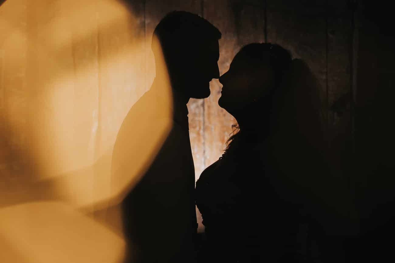 Silhouette of a bride and groom with bokeh