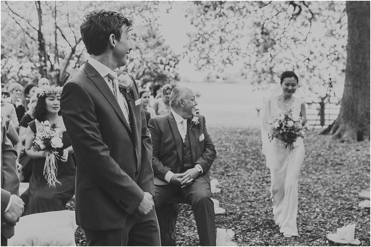 Groom's reaction to his bride walking down the aisle