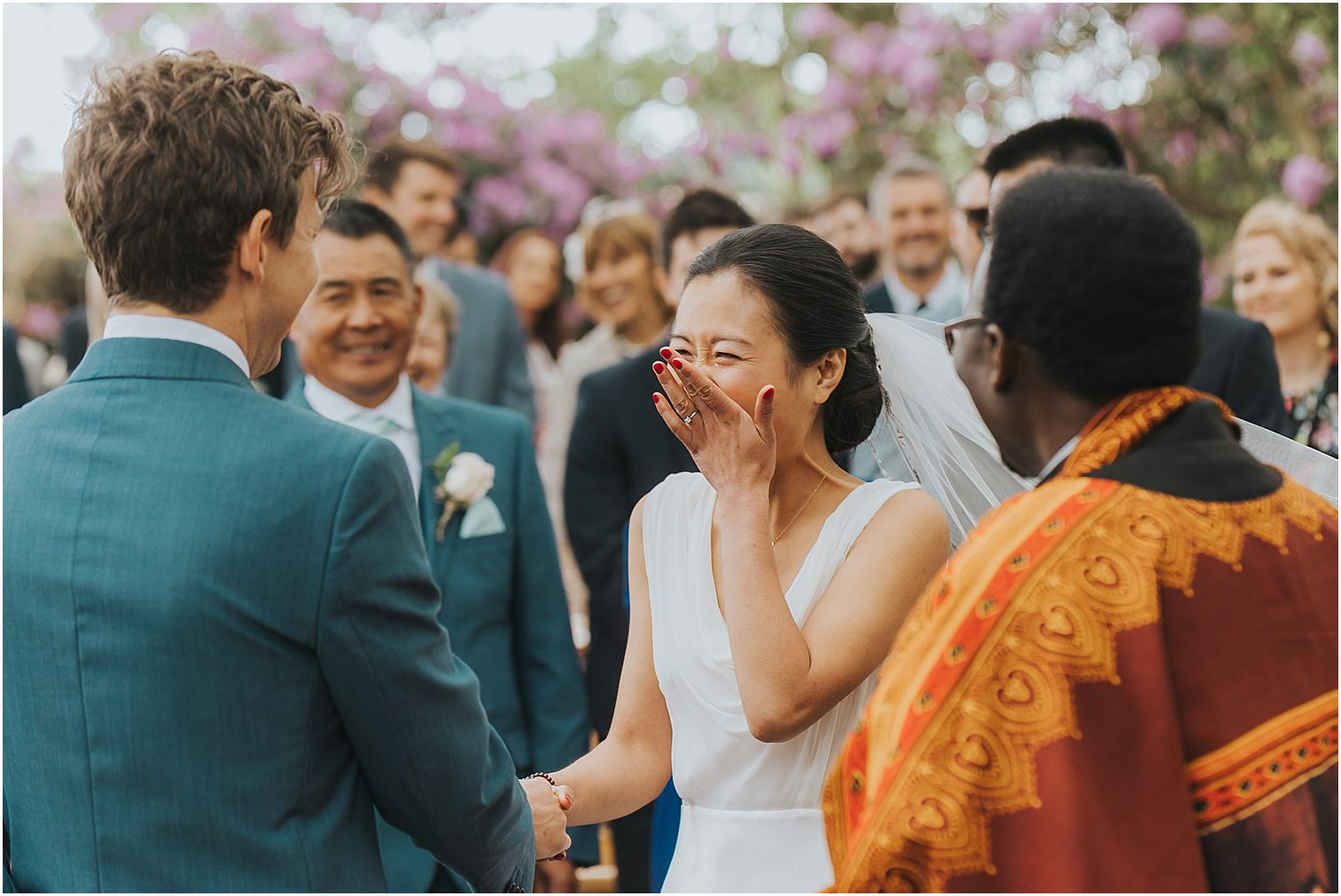 Bride reacting to a funny moment during their wedding ceremony