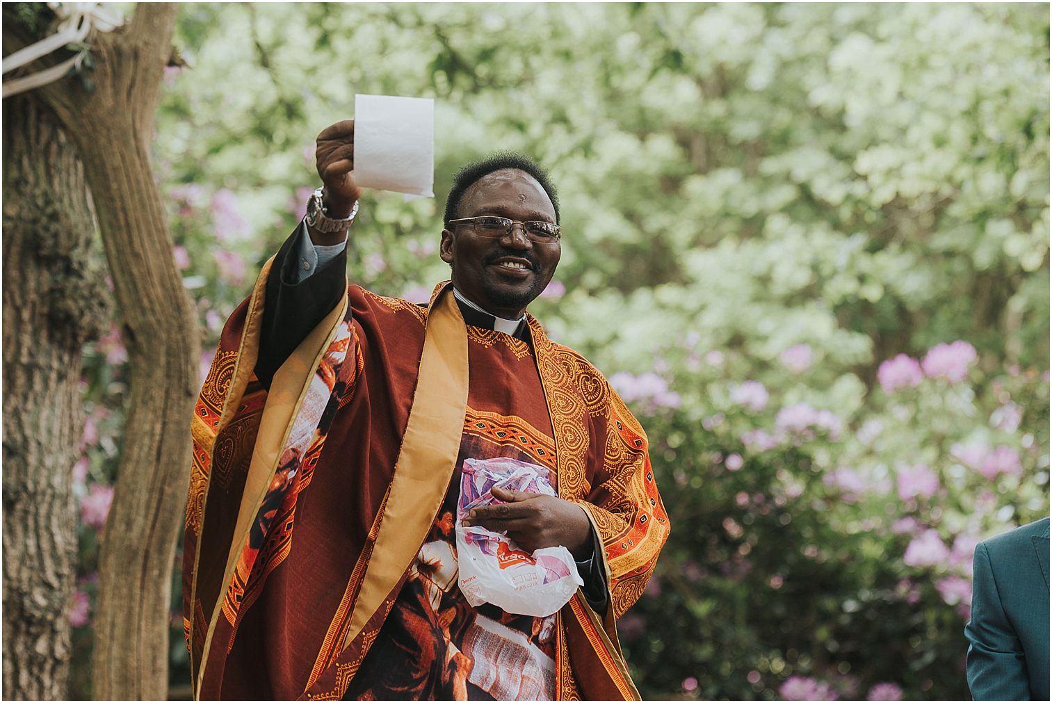 Vicar holding a roll of toilet paper during a wedding ceremony