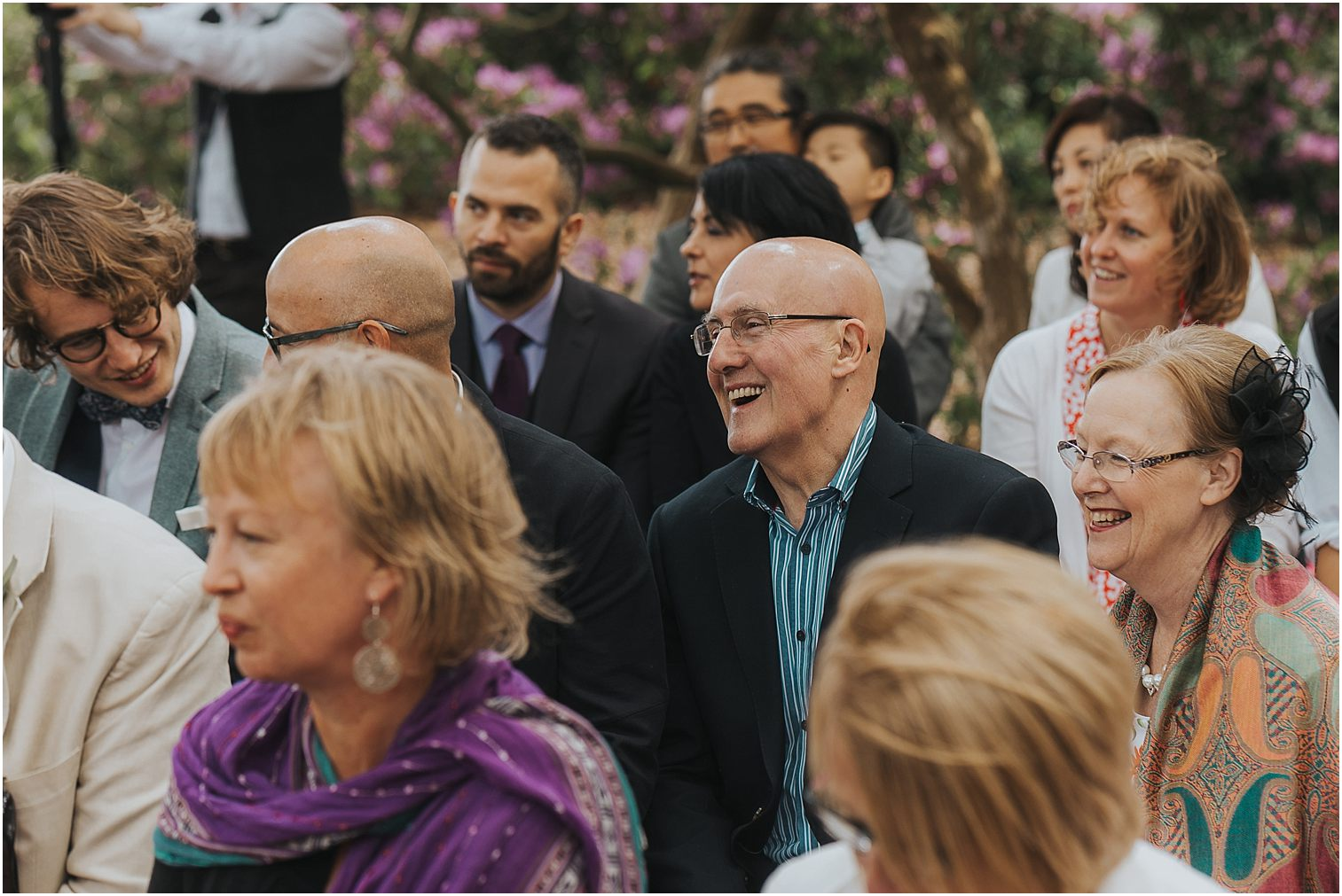 Guests at a wedding smiling
