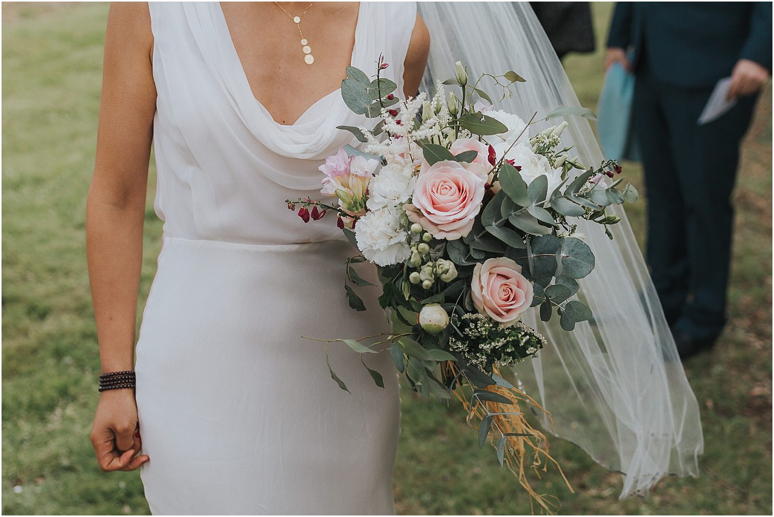 Bride holding a bouquet on her wedding day