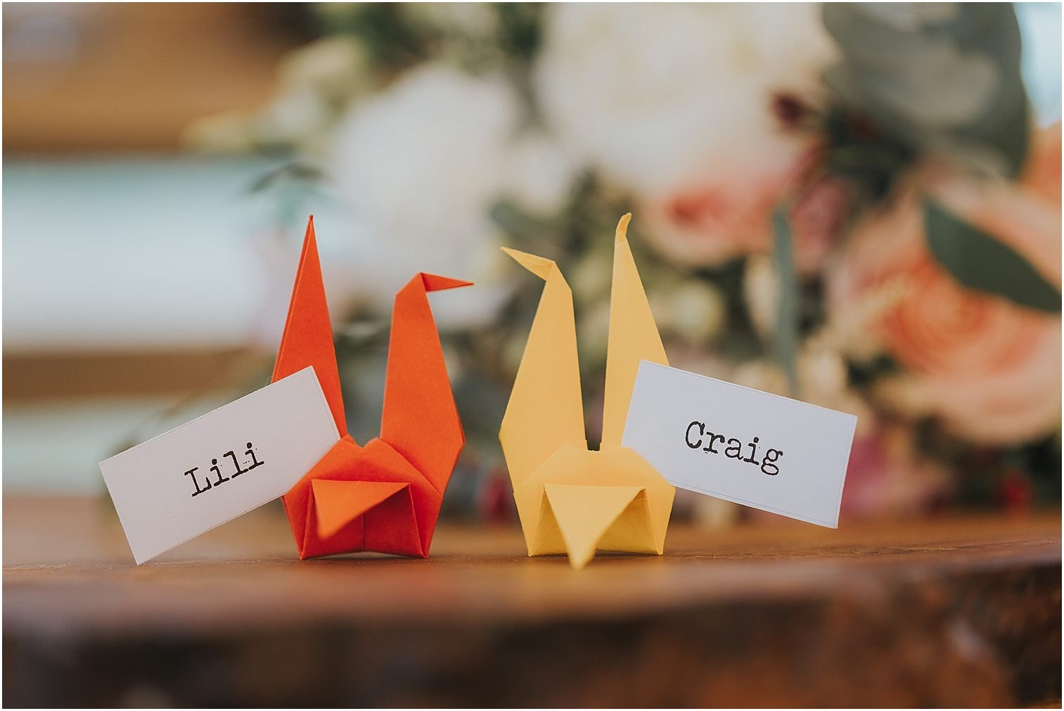 Two origami cranes used as name places