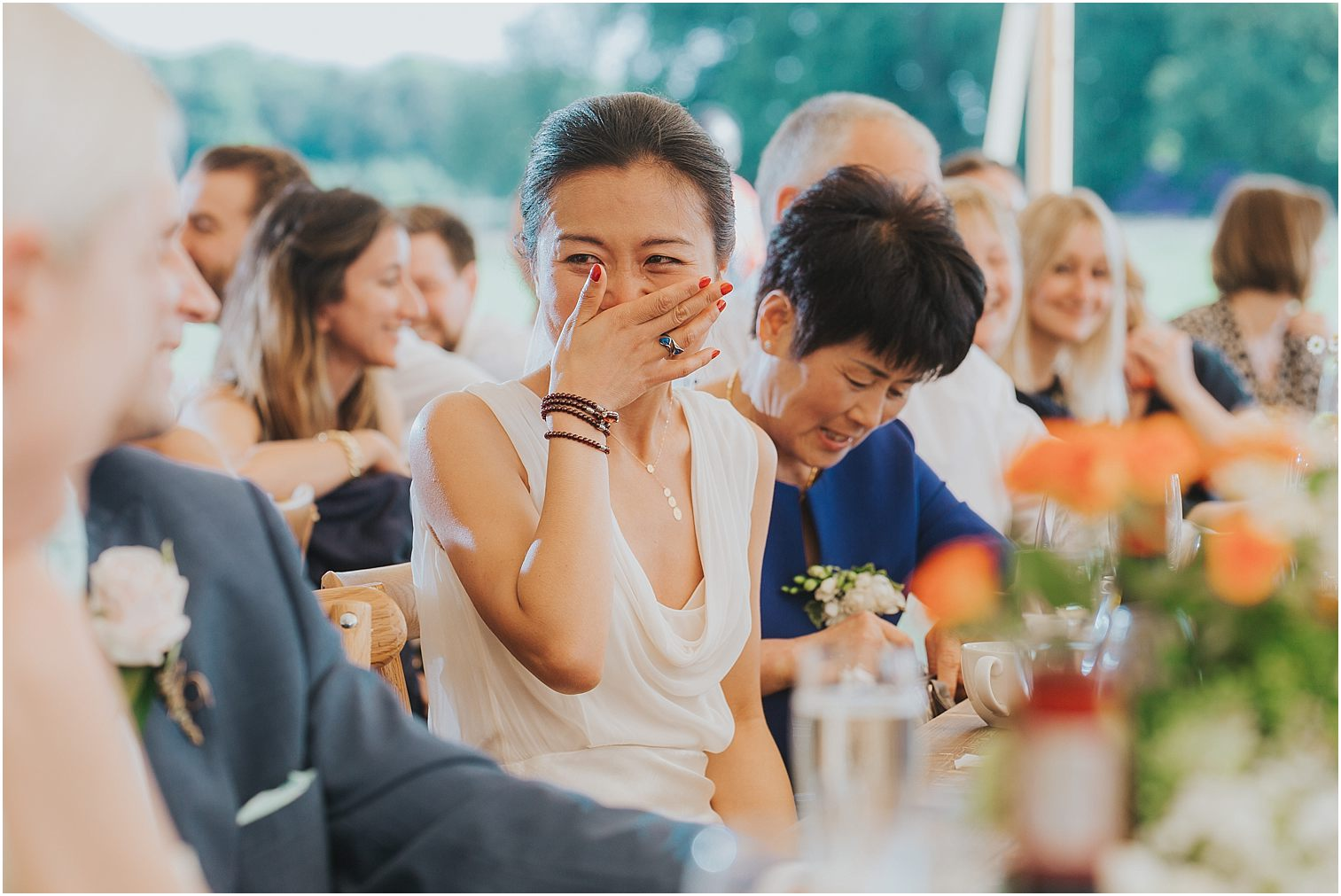 Bride reacting to her Groom's speech
