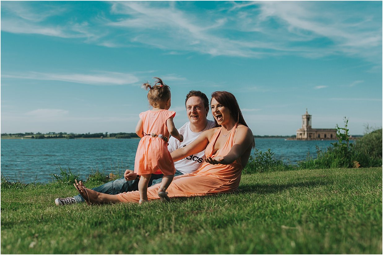 Family shot in front of Normanton Church wedding venue
