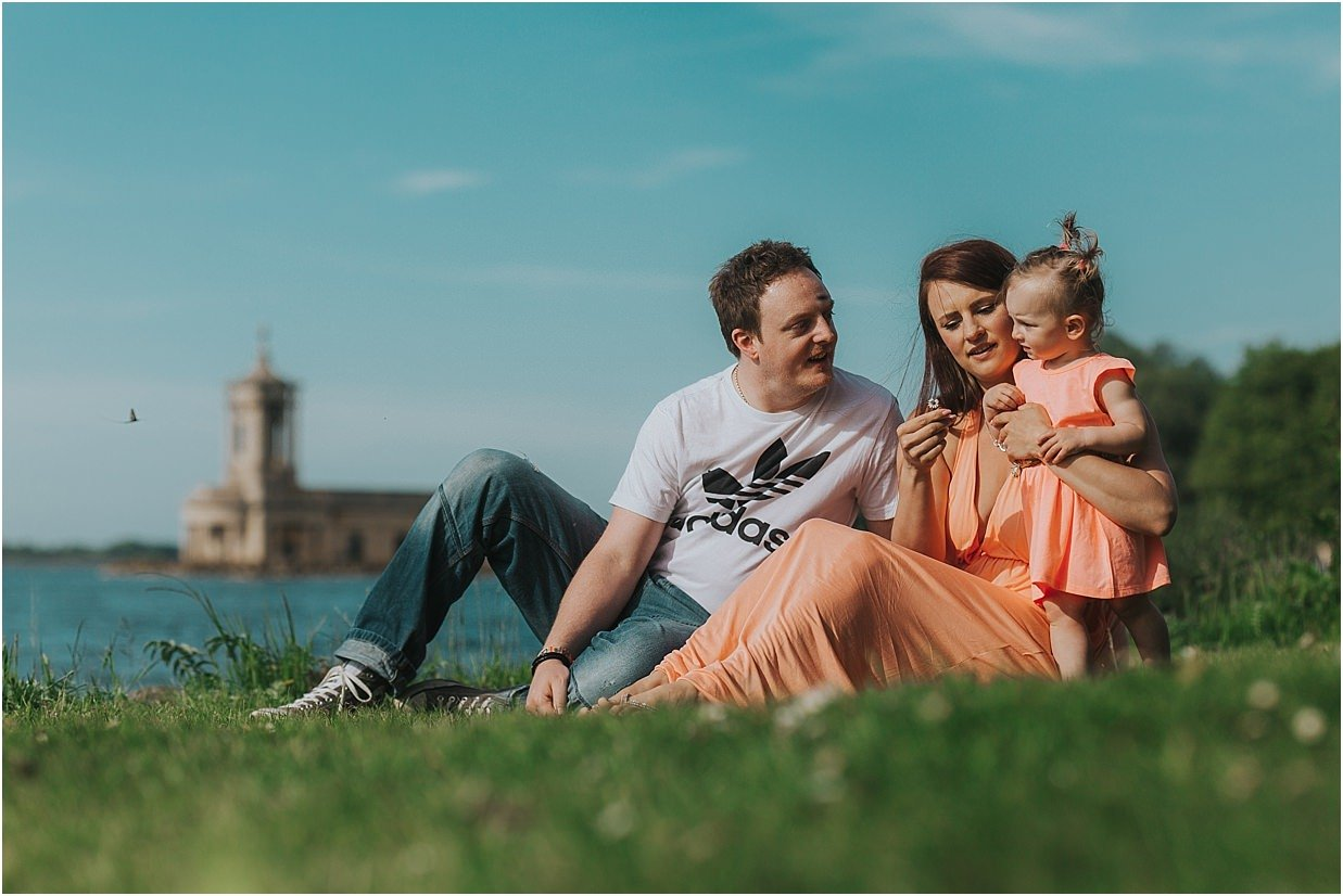 Family group posing in front of Normanton Church wedding Venue