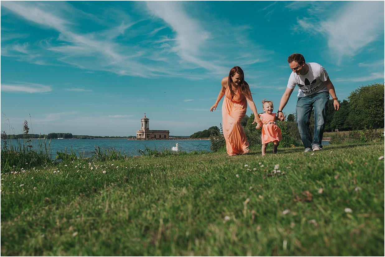 Family walking together in front of Normanton Church Wedding venue