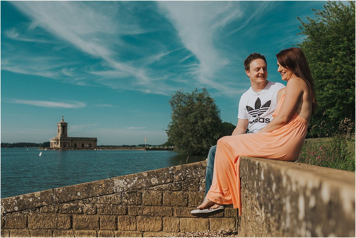 Couple posing in front of Normanton Church wedding venue Rutland water