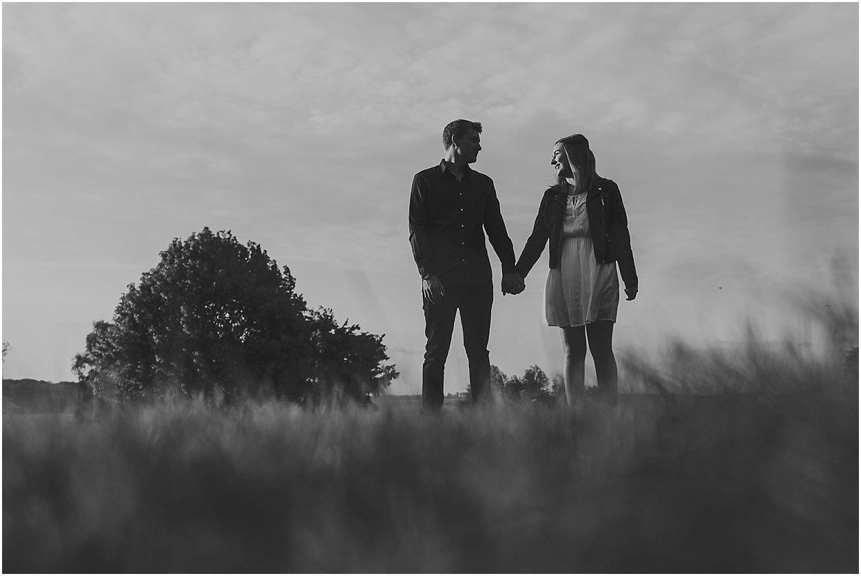 Rutland water engagement photography couple side by side holding hands