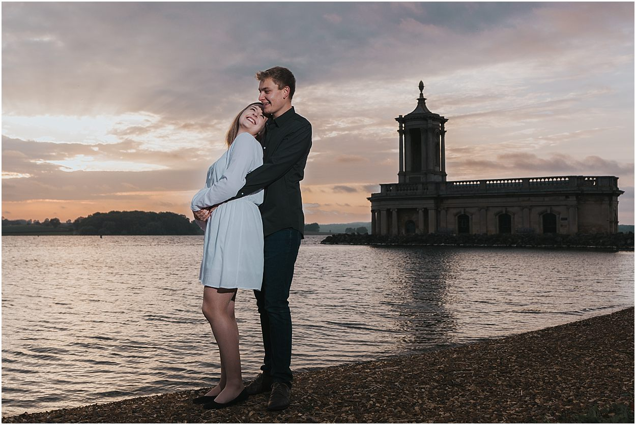 Rutland water engagement photography couple in front of Normanton Church, rutland water