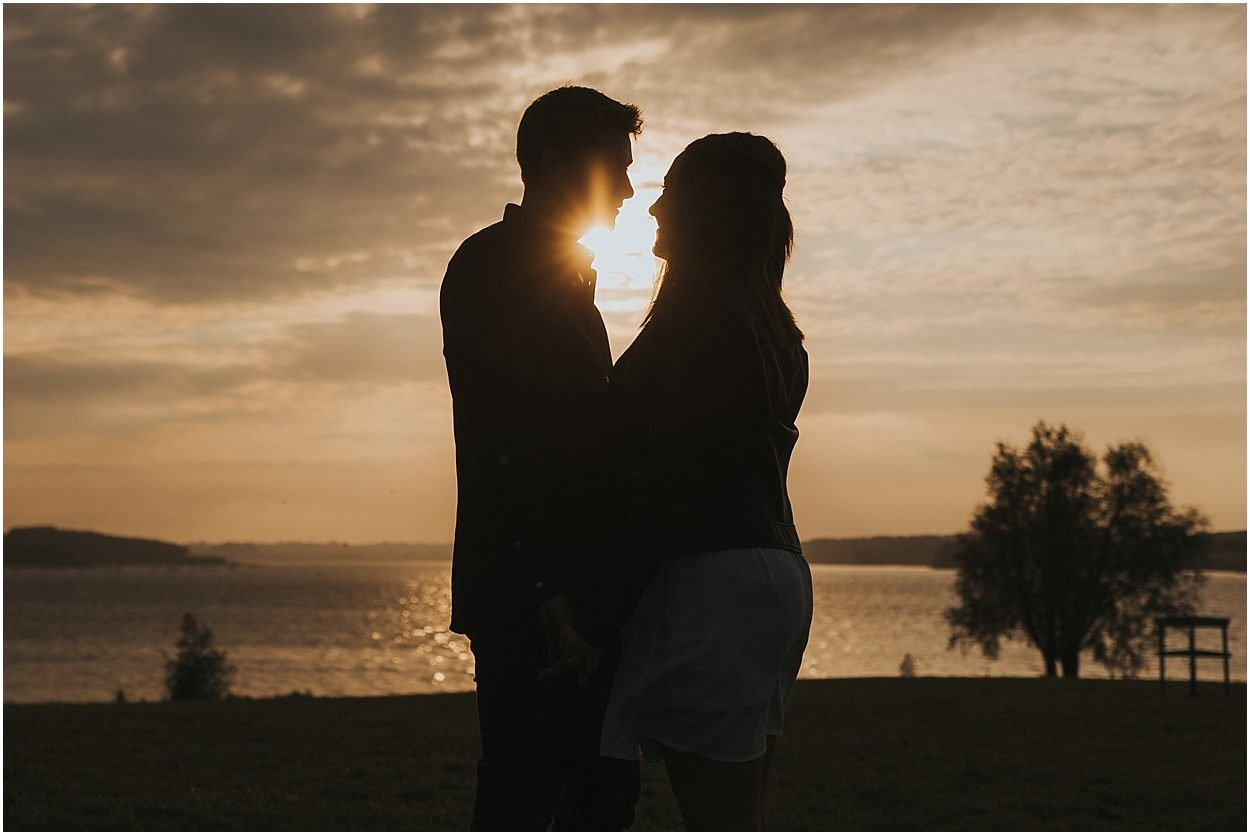 Rutland water engagement photography couple silhouetted at unset