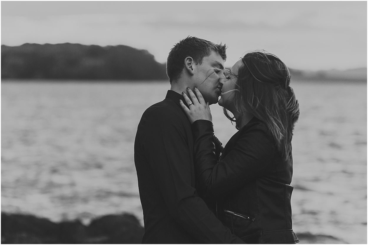 Rutland water engagement photography passionate kiss between a bride and groom