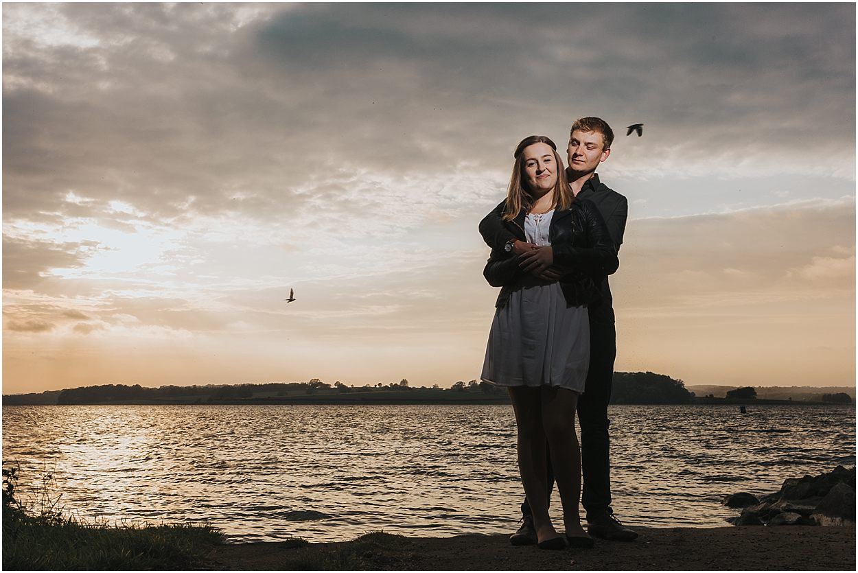 Rutland water engagement photography couple on the shore of rutland water
