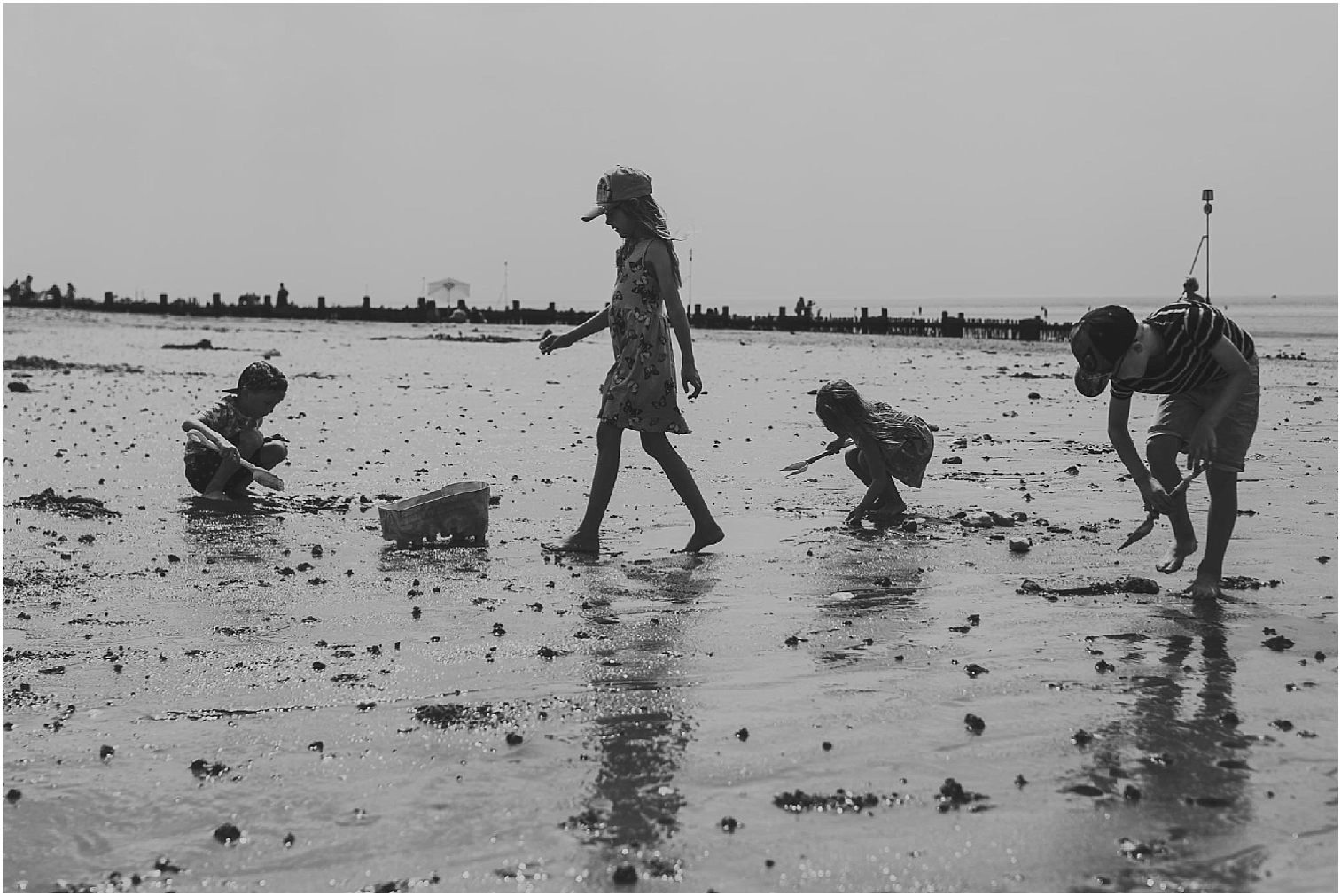 black and white image of children on a beach