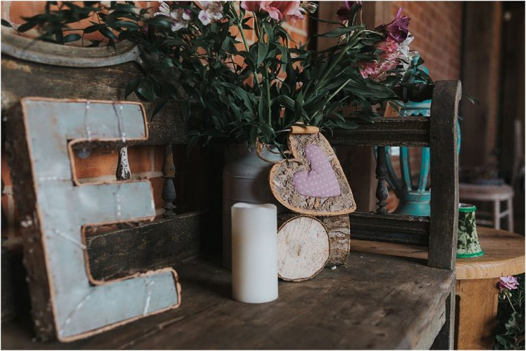 venue dressing ideas including love letters candles from a rustic wedding